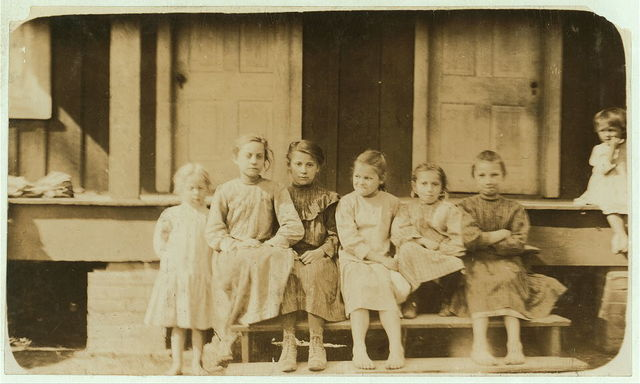 Group of oyster shuckers. Even little Tenny on the left shucks. She did not know how old she was.  Location: Pass Christian, Mississippi.