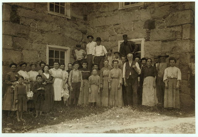 """Group showing typical workers in the small mills of Virginia, while industry is at ebb-tide. Matoaca, Va. June 1911. The little ones on left end """"only help some. Have to be 14 to work."""" Found very few very young workers. Times are slack. Many of the hands have found work in Petersburg.  Location: Matoaca, Virginia."""