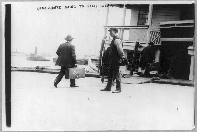 Immigrants going to Ellis Island barge