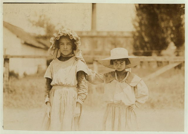 Inez Johnson (9 years old) and Lily, her cousin (7 years old). Both were helping Mrs. Johnson, a spooler in Tupelo (Miss.) Cotton Mills. Inez said she works regularly.  Location: Tupelo, Mississippi.
