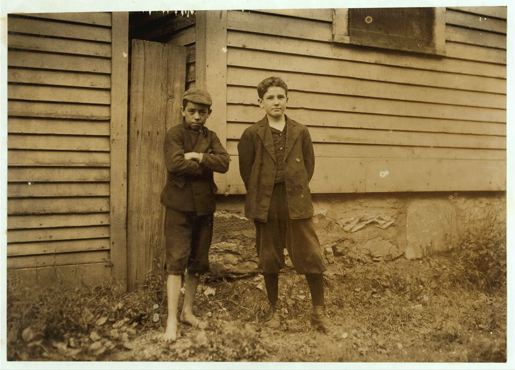 Joseph Crapo, 47 Fruit St., works in Eclipse Mills. Apparently 13 years old. Right hand. Left hand, Albert Duquette, 183 Union St. works in weave shed, putting drop wires on weave machine.  Location: North Adams, Massachusetts.