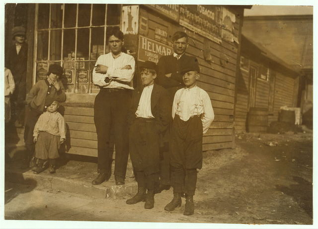 Joseph Dryjowicz, 11 Joy St., (in shirt sleeves). Has been bandboy for 7 months in #8 mill. Group of workers.  Location: Ludlow, Massachusetts.