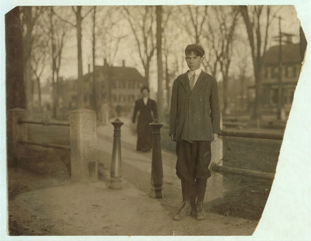 """Joseph Frank Nugent, 22 Howard St., works in Department 8A of Dennison's Factory; makes paper boxes; """"I nip the covers."""" """"One year there, 'bout time for a raise.""""  Location: South Framingham, Massachusetts."""