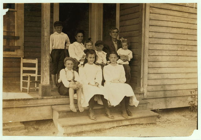 Kuyrkendall family, recently from farm. Three children in front row (one ten and one twelve) and one boy not here, work in Magnolia Cotton Mills, Magnolia, Miss. See also 2096.  Location: Magnolia, Mississippi.