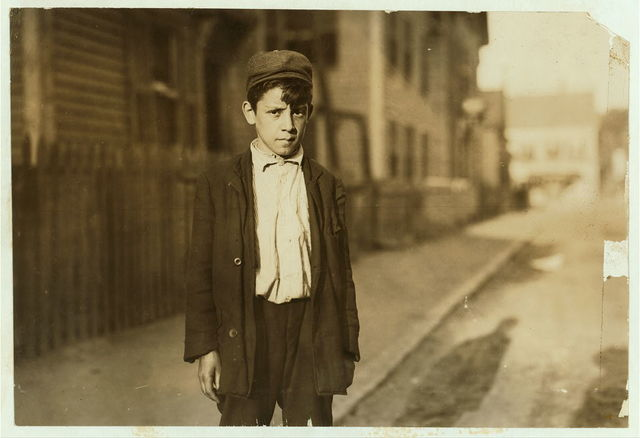 "[Leopoldo Andreoli, 208 Elm St. Very young--appears 11 or 12 years old. Is a ""Loom boy"" in spinning room of the Ayer Mill; has a steady job now and makes $5.15 a week now.]  Location: Lawrence, Massachusetts."