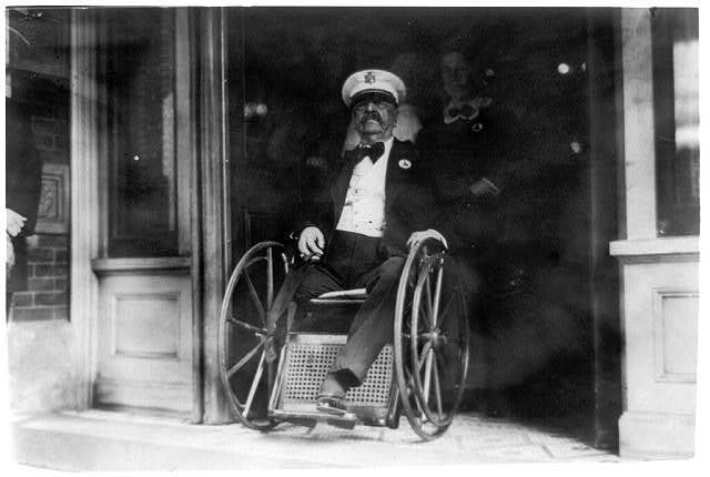 [Maj. Gen. Daniel E. Sickles in wheelchair; coming out of building]