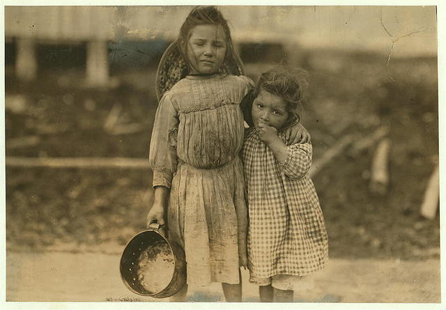 Maud Daly, five years old. Grade Daly, three years old. Each picks about one pot of shrimp a day for the Peerless Oyster Co. The youngest said to be the fastest worker.  Location: Bay St. Louis, Mississippi.