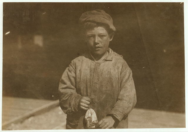 Mike Murphy, a young oyster-shucker, ten years old. Alabama Canning Co. From Baltimore.  Location: Bayou La Batre, Alabama.