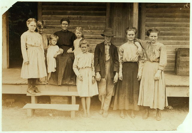 "Mrs. Streety (a widow) and family. West Point, Miss. The four children on the ground work in the mill. Oldest makes 90 cents a day, - the next, 70 cents, - the boy 30 cents, (""He's slow,"" they said.) and Eva makes 28 cents a day. Eva is learning to spin. Can run two sides soon. She is 12 now (which is doubtful) but said that she learned [to] spin before she was 12.  Location: West Point, Mississippi."