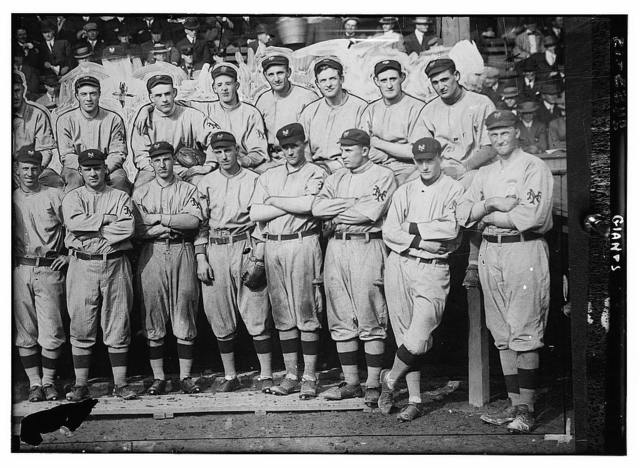 [New York Giants. Top row (left to right): (partially obscured) Art Fletcher, George Burns, Art Wilson, Red Ames, Art Devlin, Christy Mathewson, Hooks Wiltse, Grover Hartley. Bottom row: Beals Becker, John McGraw, Buck Herzog, Fred Merkle, Bert Maxwell, Doc Crandall, Gene Paulette, and an unknown player (baseball)]