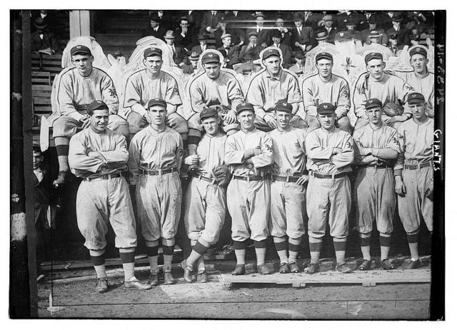 [New York Giants. Top row (left to right): Rube Marquard, Larry Doyle, Josh Devore, Art Fletcher, George Burns, Art Wilson, Red Ames. Bottom row: Chief Meyers, Fred Snodgrass, Red Murray, Arlie Latham, Beals Becker, John McGraw, Buck Herzog, Fred Merkle (baseball)]