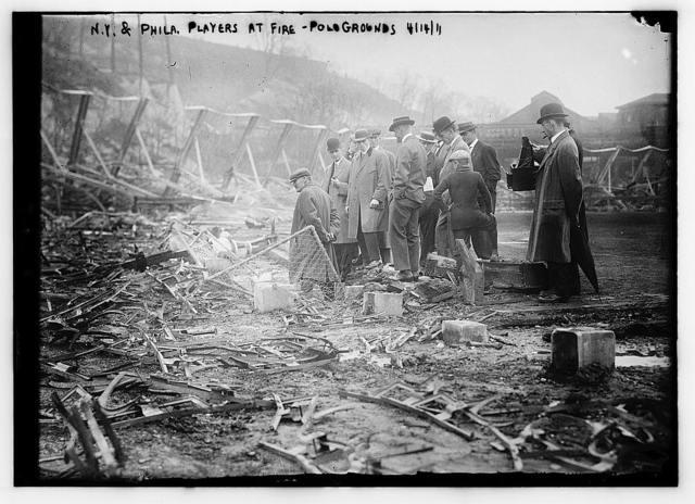 [New York, NL & Philadelphia, NL players view fire damage, Polo Grounds