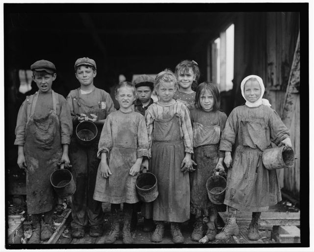 Nine of these children from 8 years old up go to school half a day, and shuck oysters for four hours before school and three hours after school on school days, and on Saturday from 4 A.M. to early afternoon. Maggioni Canning Co.  Location: Port Royal, South Carolina.