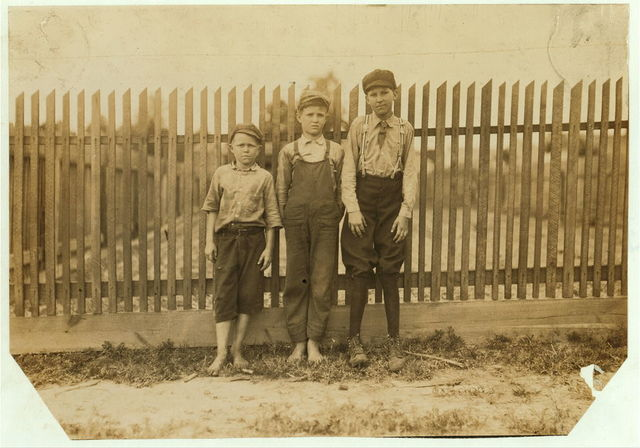 Noon at Delta Cotton Mills, Mc Comb, Miss. Three of the young workers.  Location: McComb, Mississippi.