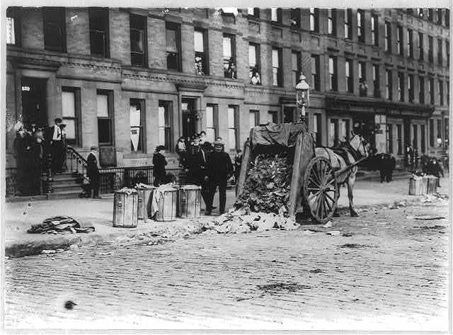 [N.Y.C. Garbage collector's strike, 1911: horse-drawn garbage cart dumped on street; 72nd St. & 1st Ave.]
