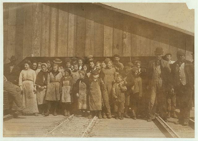 Oyster-shuckers working in Alabama Canning Company. From 7 years upward.  Location: Bayou La Batre, Alabama.