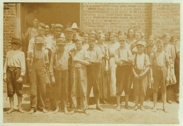 Part of the force at Tupelo (Miss.) Cotton Mills. All work. Smallest ones not in photo. Among youngest here are: Coleman Miller, has been working one year, cannot write name, said twelve years old but doesn't appear to be. Zamie Scott, one year working. Guy Sanders, and Luceon Kendreck.  Location: Tupelo, Mississippi.