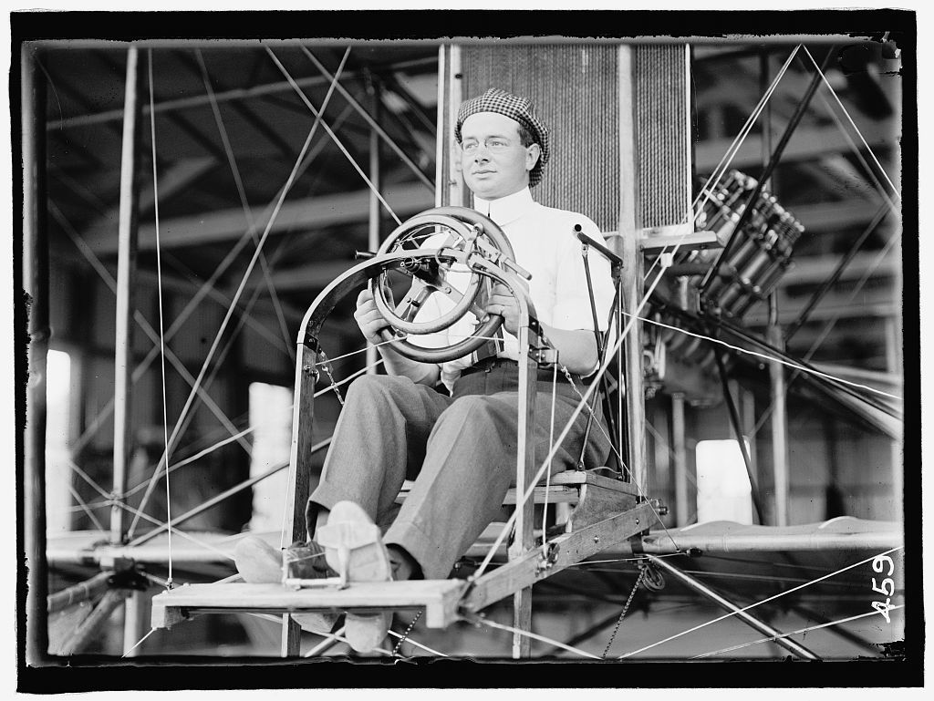 PECK, PAUL. COMMERCIAL AVIATOR. IN CURTISS TYPE PLANE; COLLEGE PARK