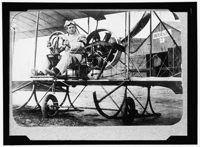 PECK, PAUL. COMMERCIAL AVIATOR. IN GYRO TYPE PLANE SPONSORED BY BERLINER AT MINEOLA, N.Y.