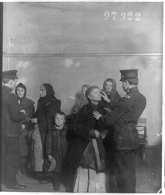 [Physical examination of female immigrants at Ellis Island, New York City]
