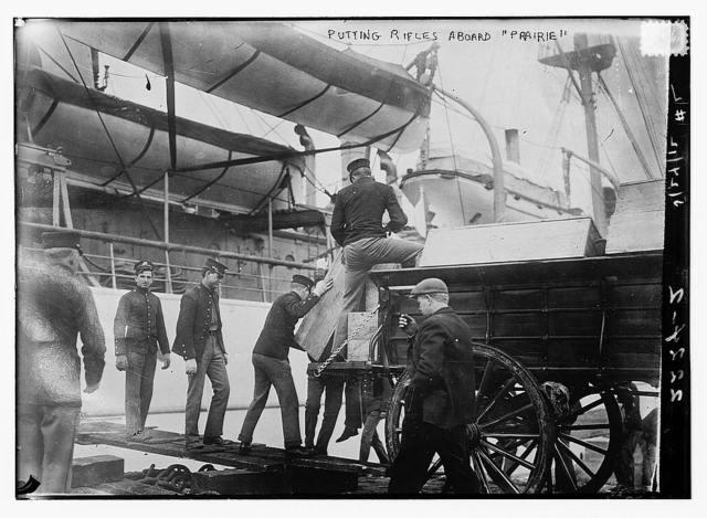 Putting rifles aboard PRAIRIE
