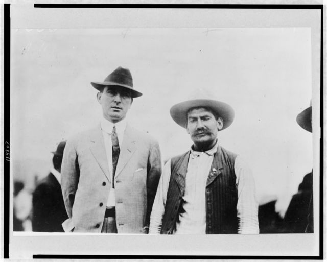 "[""Red"" Lopez, Mexican insurrecto leader (right) and M.J. Brennan of Atlanta (left), posed standing, half-length]"