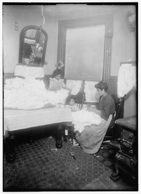 Rose Vetrano, 9 yrs. old, helping her mother on corset-covers, 71 Sullivan St., 3rd floor back.  Location: New York, New York (State)