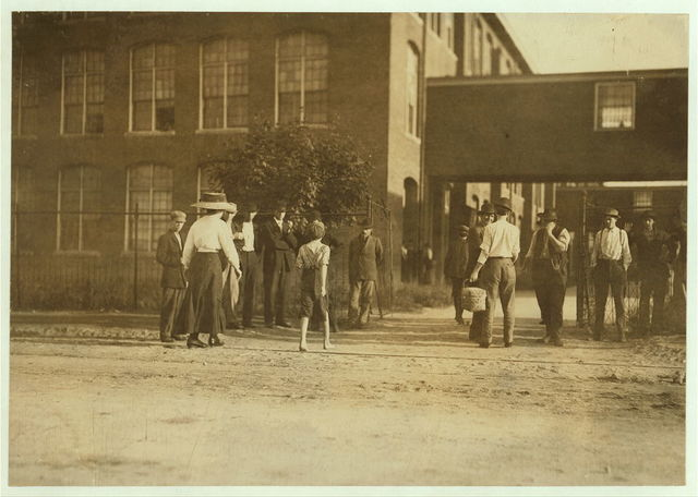 Schoolfield Cotton Mills, Danville Va. Going to work; 6:30 A.M. June 9, 191[1] A few young boys and girls under 14, work in these mills, but not many, and they are large mills.  Location: Danville, Virginia.