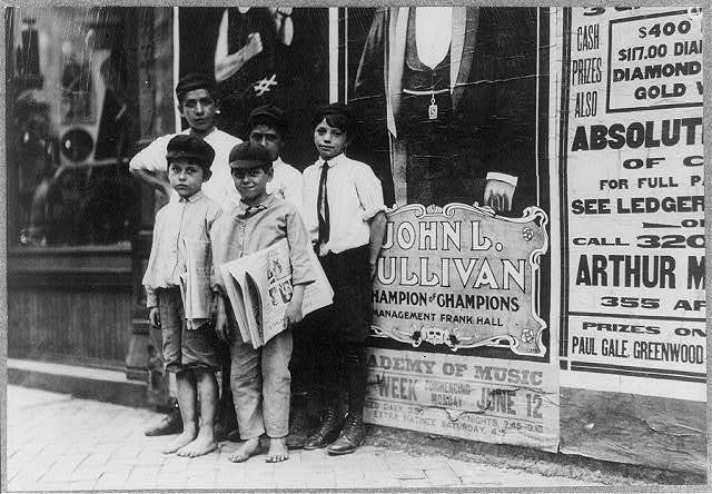 Some of the Norfolk newsies and their environment. Many very small boys sell newspapers in the Virginia cities.  Location: Norfolk, Virginia.