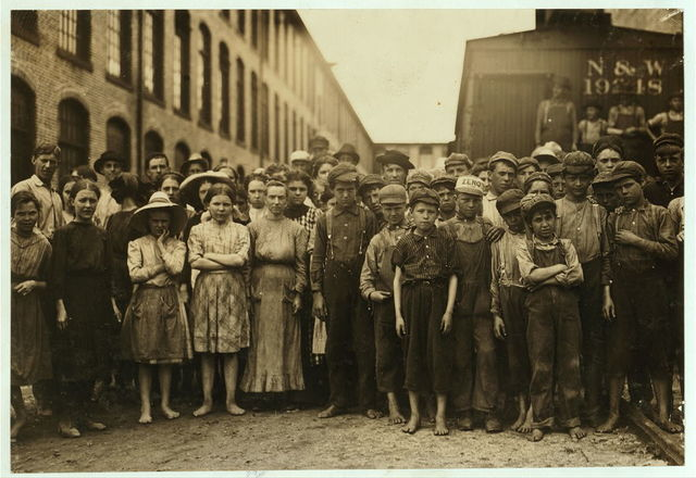 "Some of the youngsters working in the spinning rooms of the Washington Cotton Mills, Fries, Va. Posed by the overseer, who said, ""These boys are a bad lot."" When questioned, they all said they were fourteen yrs. old or more.  Location: Fries, Virginia."