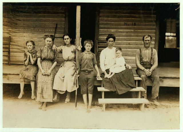 "The Duncan Family, West Point, Miss. All in the cotton mill except mother and babe. The boy, Bill, said, ""I'm fifteen now. Been workin' in this mill eight years. Wasn't no law fer little ones when I went in.""  Location: West Point, Mississippi."