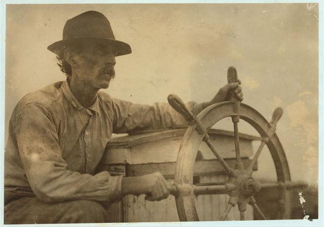 The Skipper on the Oyster Barge, Mobile Bay.  Location: Bayou La Batre, Alabama.