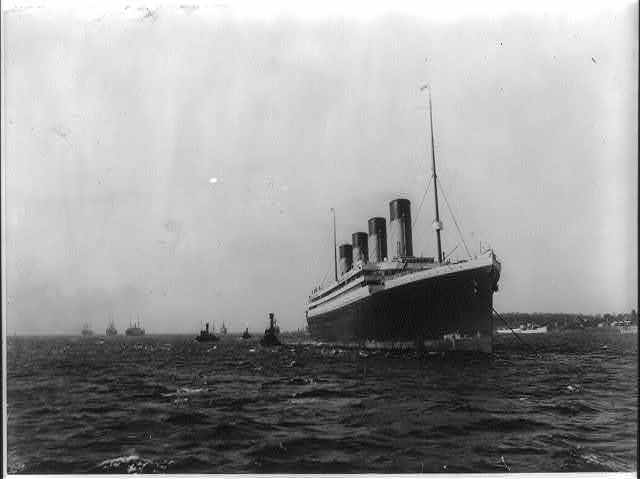 [The S.S. OLYMPIC, 1911: Anchored in New York Harbor, with bow in foregrd.]
