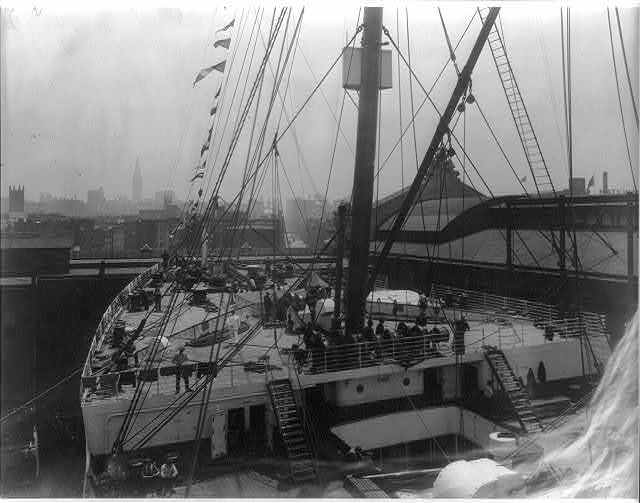 [The S.S. OLYMPIC, 1911: Fore deck at dock in New York Harbor]
