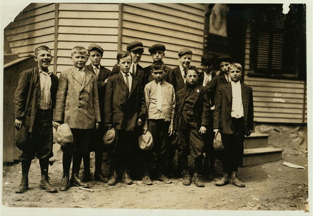 These boys all said they worked in the Everett Mill, another boy told me that the smallest boys do not work. There [sic] names are John Pickacki, 84 Union Street, smallest boy in the picture said he worked in the Warp spinning room. Charles Wuest, 43 Brooks Street, next smallest in picture said he worked in drawing-in room.  Location: Lawrence, Massachusetts.