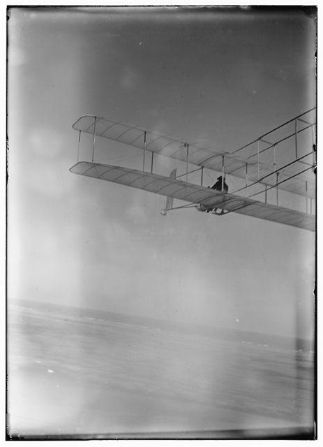 [Three-quarter left rear view of glider in flight at Kitty Hawk, North Carolina]