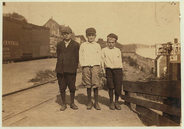 Three young cutters who work in the Seacoast Canning Co., Factory #4, Eastport, Me. They work at night when the rush is on. Youngest is Rob Collins, 10 years old; next is Dan Collins, 11 years; next is Milton Shannon. All live on South Clark Street.  Location: Eastport, Maine.