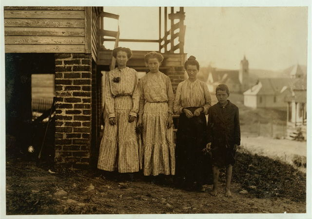 Tommy Bullard and his family. He has been sweeping for over a year in Washington Cotton Mills, Fries, Va. Said he was 13, but it is doubtful. Mother is a widow. Sisters in the mill too. Family came a year ago from a farm at Elkins, N.C.  Location: Fries, Virginia.