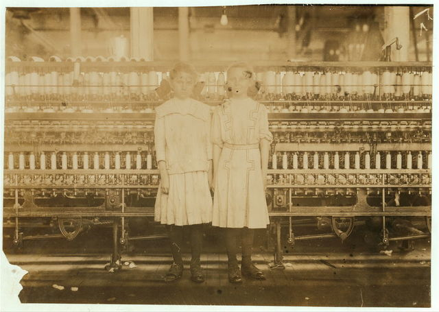 Twin sisters Winnie and Jimmie. Spinners in Yazoo City (Miss.) Yarn Mills. Said thirteen years old, but see photo and label 2102.  Location: Yazoo City, Mississippi.