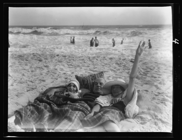Unidentified man and two women at Long Beach, New York