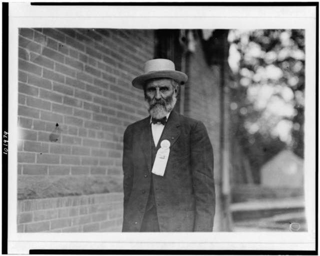 [W.C. Round, Confederate veteran, half-length portrait, standing, facing slightly left, wearing badge during celebration at Bull Run]