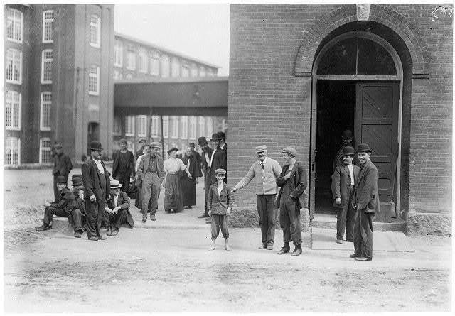 "While I was photographing these workers (Berkshire Mills) the watchman dragged out the smallest boy, saying, ""Here, photograph 'Peewee'.""  Location: Adams, Massachusetts."