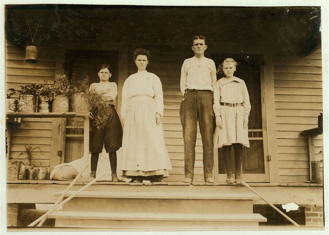 Widow in the mill. Girl at home. The McFarland Family, Winona Miss. Cotton Mills. Mother and sons work in the mill. The girl keeps house. Youngest boy has been in the mill five years.  Location: Winona, Mississippi.