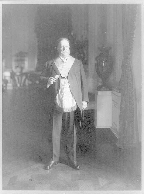 [William Howard Taft, full-length portrait, standing, facing right, in a mason's garb]