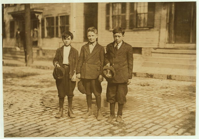 Willie Payton, (boy in middle), 196 Fayette St., Said 11 years old, made over $2 last week as pin boy in Les Miserables Alley, works there every night until about midnight. Joseph Philip (shortest boy on end). see previous dates. Frank Wojcick, (tallest boy), 7 Wall St., said 13 years, pin boy in Y.M.C.I. Alleys until 11 and 12 P.M. Every week day.  Location: Lowell, Massachusetts.