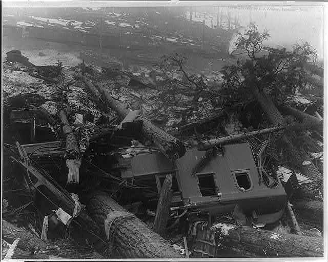 [Wreck of train in foregrd. caused by an avalance at Wellington, Wash. Mar. 1, 1910]