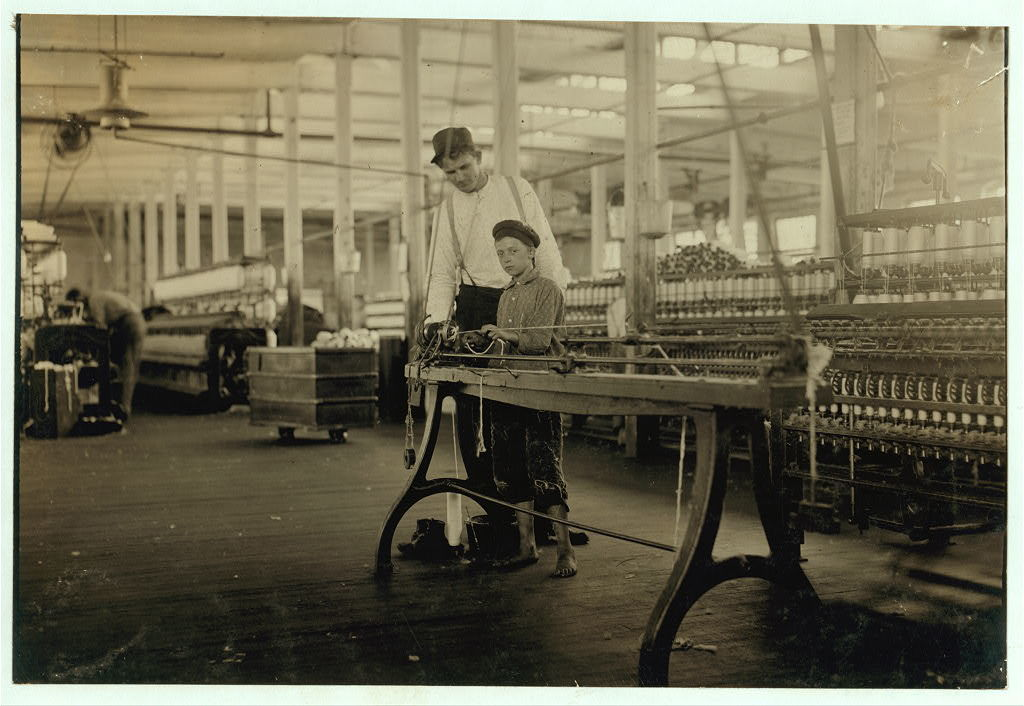 "Young ""Band-boy"" and overseer, Yazoo City Yarn Mills.  Location: Yazoo City, Mississippi."