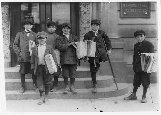 "3 P.M. Some of the boys at a busy trolley junction. 3 brothers, Salvatore, 9 yrs. (in front), Joseph, 11 yrs. (cripple), Lewis, 13 yrs. (between these 2). ""We would be murdered if we shop craps."" Boy at left sold me pair of dice for 2 c[en]ts. - what he would have to pay for more.  Location: Jersey City, New Jersey."