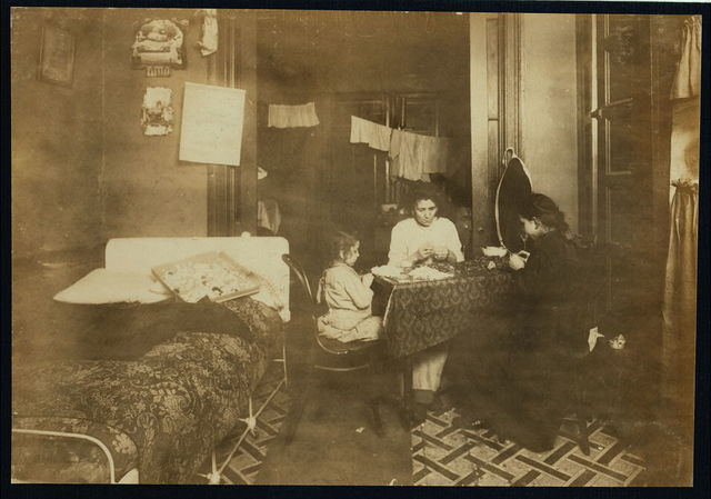 """3:30 P.M Mrs. Mary Femenella, 137 Thompson Street. Annie 12 yrs. old works sometimes until 10 P.M. making flowers. A brother 9 yrs. old not in the picture works after school also. Little Rosie 5 yrs. old works some every day. Often they make $2 to $2.50 a week. """"Father he loafs, sells bottles sometimes.""""  Location: New York, New York (State)"""