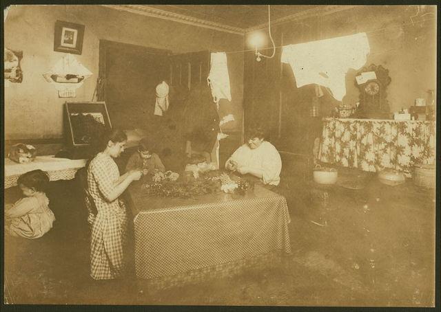 4:30 P.M. Flora Anseline, a busy girl. 5 Carmine St., N.Y. She goes to school, helps mother with housework, and makes flowers, working some nights until 10 P.M. The little boy helps some. Flora was 14 years old to-day, and said she expects to go to work as dressmaker soon.  Location: New York, New York (State)